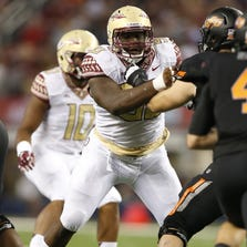 Aug 30, 2014; Arlington, TX, USA; Florida State Seminoles defensive tackle Eddie Goldman (90) in action against the Oklahoma State Cowboys at AT&T Stadium. Mandatory Credit: Matthew Emmons-USA TODAY Sports