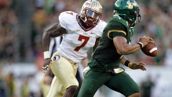Florida State senior linebacker Christian Jones is expected to rush the quarterback much more in 2013. The former five-star prospect, who led the team in tackles a season ago but had zero sacks, has been getting reps at defensive end in the preseason. Glenn Beil/Democrat Christian Jones, 7, persues quarterback B.J. Daniels as the Florida State Seminoles visit the South Florida Bulls at Tampa Bay's Raymond James Stadium on Saturday Sept., 29, 2012.