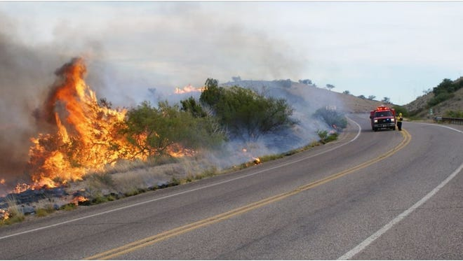 Wildfire crews were being diverted from the Oak Tree Fire burning north of Sonoita on May 22, 2015 after blaze's growth was checked.