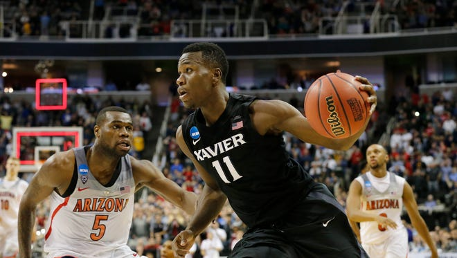Xavier Musketeers guard Malcolm Bernard (11) drives down the court as time expires in the second half.