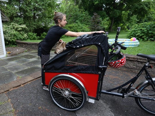 Delivery time: Brooke Fossey loads up her Danish cargo bike with a couple orders of bagels freshly made in her home kitchen.