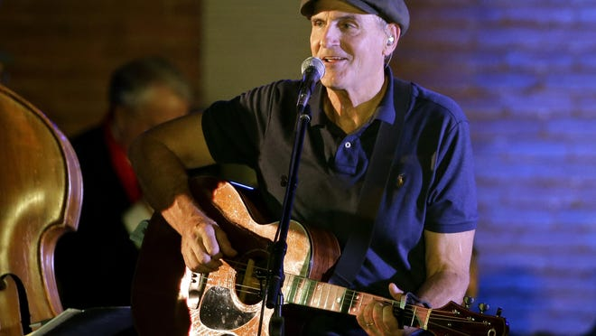 James Taylor performs during a campaign event for Democratic presidential candidate Hillary Clinton, in Manchester, N.H. The singer says in a Thanksgiving e-mail that giving thanks is the key to overcoming setbacks.