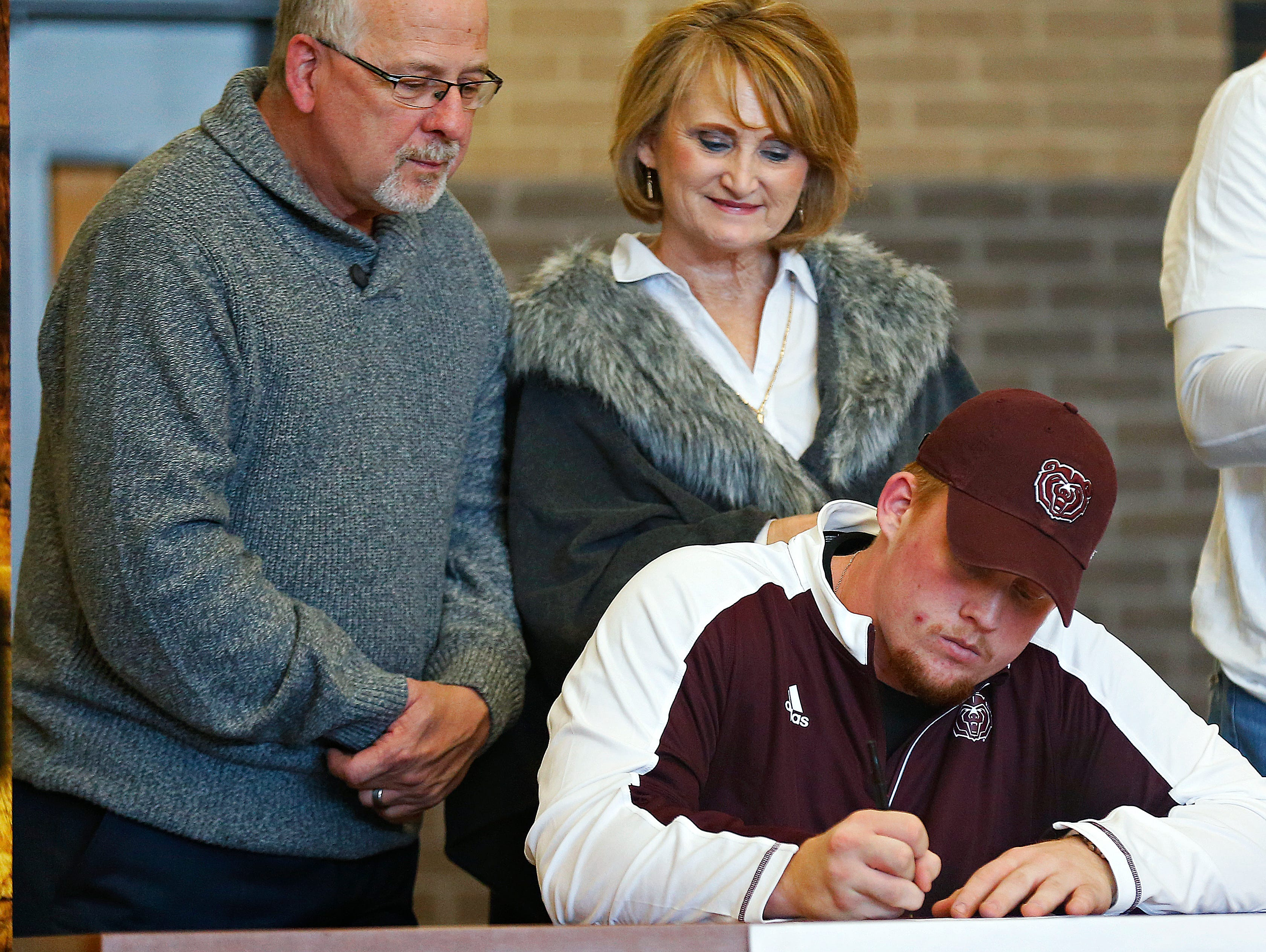 Grant Martin signs a national letter of intent to Missouri State University during a National Signing Day ceremony held at Kickapoo High School in Springfield, Mo. on Feb. 1, 2017.