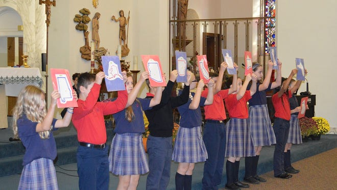 Bishop Schad Regional School in Vineland held its annual Veterans Day Prayer Service on Nov. 11. During the service, the students held up pictures of states to acknowledge and show their support and thanks to veterans from throughout the country.