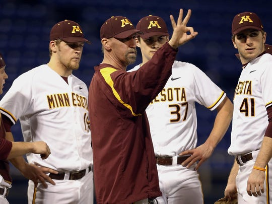 Minnesota Gophers pitching coach Todd Oakes calls for a new pitcher in the sixth inning of an NCAA baseball game on Feb. 27, 2013, in Minneapolis. Oakes died after a battle with leukemia.