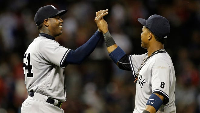 New York Yankees relief pitcher Aroldis Chapman, left, and Starlin Castro celebrate after the Yankees defeated the Cleveland Indians 5-4 in a baseball game, Thursday, July 7, 2016, in Cleveland.