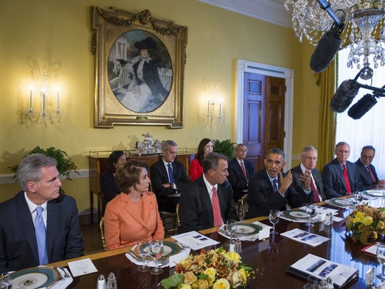 President Barack Obama meets with congressional leaders in the Old Family Dining Room of the White House in Washington. From left are, House Majority Leader Kevin McCarthy of California, House Minority Leader Nancy Pelosi of California, House Speaker John Boehner of Ohio, Obama, Senate Majority Leader Harry Reid of Nevada, Senate Minority Leader Mitch McConnell, R-Ky., and Rep. Charles Schumer, D-N.Y.