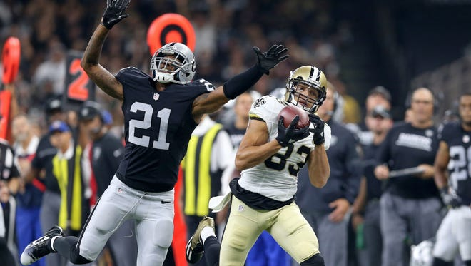New Orleans Saints wide receiver Willie Snead makes a catch while defended by Oakland Raiders defensive back Sean Smith in the second quarter Sunday at the Mercedes-Benz Superdome.