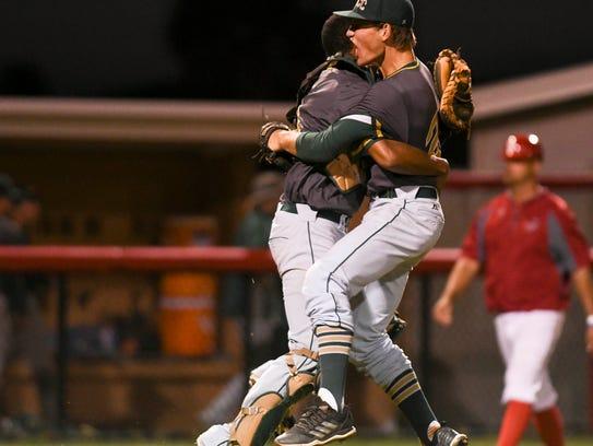 Nick Durgin and Kevin Espiritusanto celebrate the Hustlers district baseball title Friday at Satellite High School.