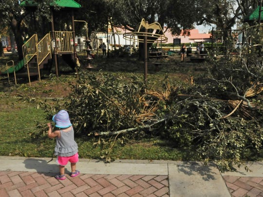Livi Daniels, 3, was doing her part to clean the park.