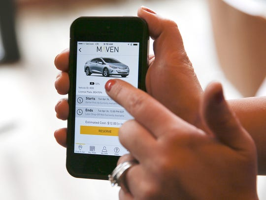 A smartphone displays the Maven app, a General Motors