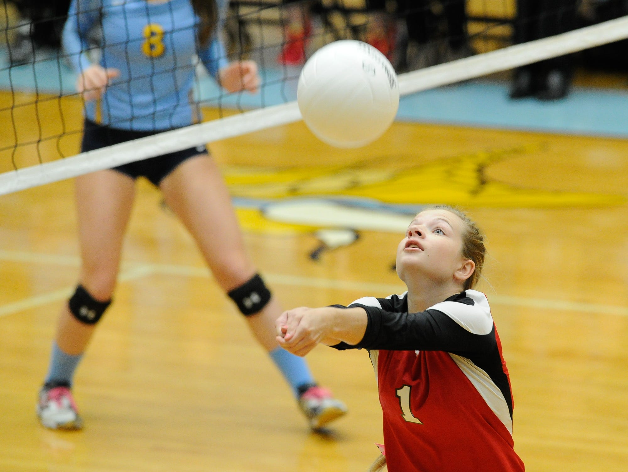 Conrad's #1 Lindsay Burg with a bump set in the first game against Cape Thursday night at Cape Henlopen High School.
