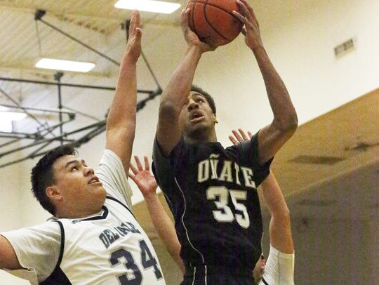 Oñate's Johnny McCants, 35, rises for a shot against