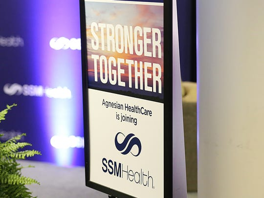A sign announcing the transfer of sponsorship of Agnesian HealthCare from the Congregation of Sisters of St. Agnes to SSM Health sits just off a stage Thursday, where the announcement of the transfer was made at St. Agnes Hospital in Fond du Lac.