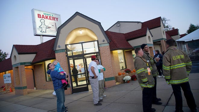 """After a devastating Christmas Eve fire, Serpe's Bakery in Elsmere reopenedat 7 a.m. Friday morning with a """"blessing of the building."""""""