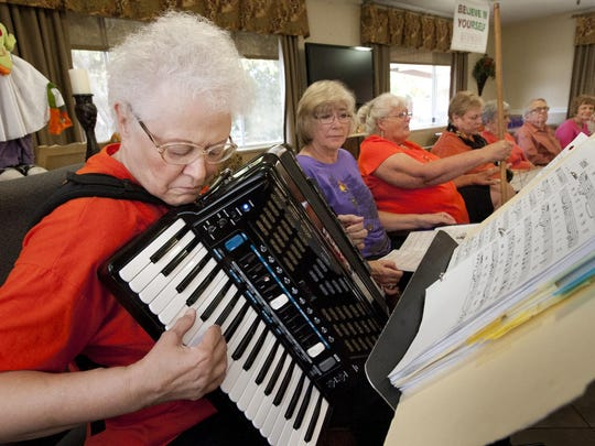 LaVerne Spitler plays her digital accordion for the Visalia Volunteer Singers. They perform at retirement homes around Visalia such as Redwood Springs Healthcare Center on Friday, October 23, 2015.