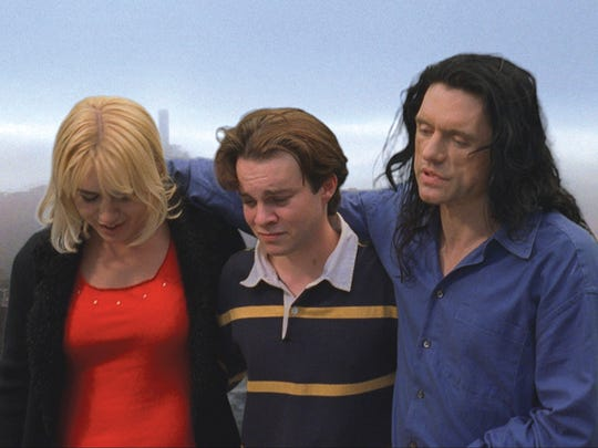 "Juliette Danielle, left, Philip Haldiman, center, and Tommy Wiseau are shown in a scene from ""The Room."""