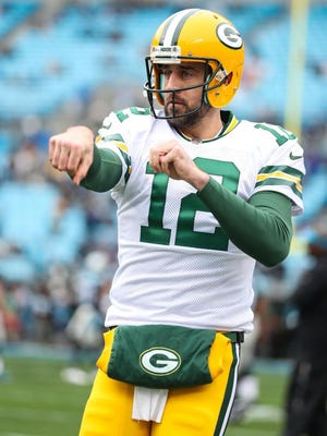Green Bay Packers quarterback Aaron Rodgers (12) warms up prior to the start  of the first quarter against the Carolina Panthers at Bank of America Stadium.