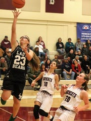 Cloudcroft's Kaylee Hickman, left, tries to make a layup Tuesday night.