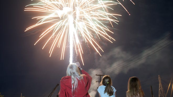 I was lucky to get this photo ofDebbie Saxton, 8-year-old Emily Pride and 7-year-old Rachel Pride watching fireworksfrom the corner of Keen and GW Morse streets in Zanesville. Shooting fireworks for me is a lot of luck and shooting a lot of frames hoping to catch something in the air.