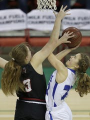 Amherst's Lindsay Dose (22) puts up a shot against Marshall's Anna Lutz.