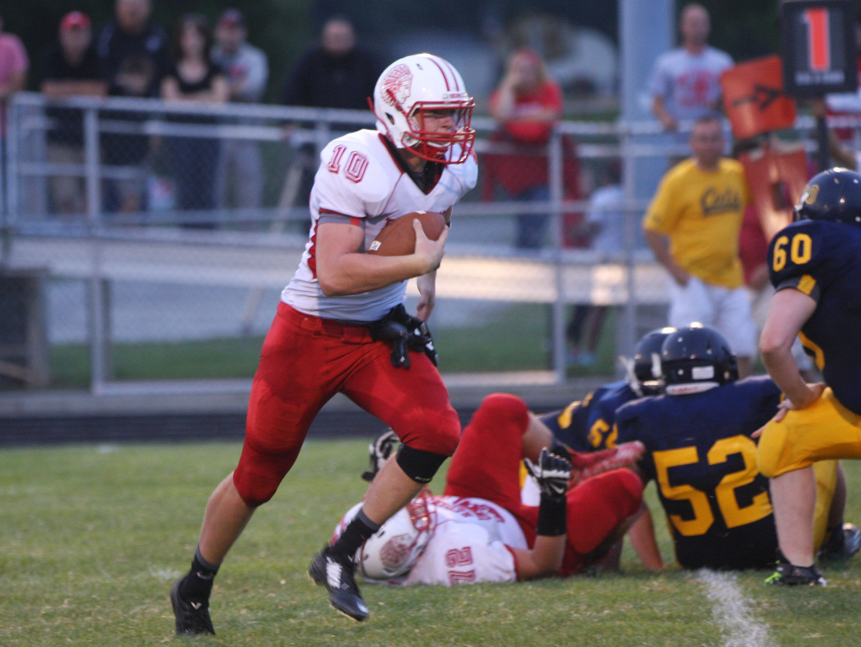 Port Clinton's Joey Brenner rushes for yardage against the Woodmore defense.