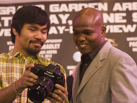At left Manny Pacquiao and Timothy Bradley Jr. pose for photographs at the end of their West Coast promotional press conference at The Beverly Hills Hotel for their upcoming fight on June 9, 2012 in Las Vegas, Nevada.