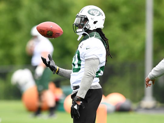 New York Jets runningback Isaiah Crowell #20 juggles the ball during the first day of OTA's in Florham Park, NJ on Tuesday, May 22, 2018.