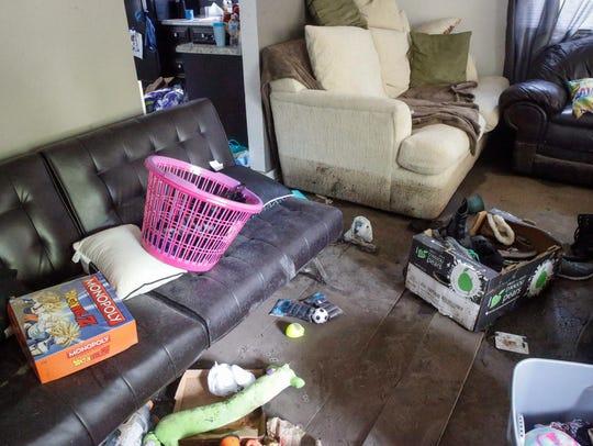 Amanda Hatfield's living room is littered with debris
