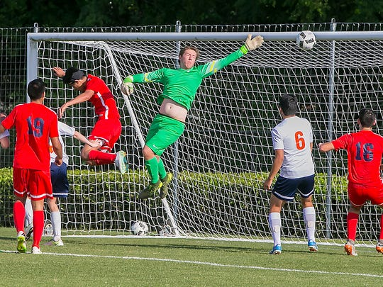 Blackman's goalkeeper Colin Dunkley deflects the Oakland