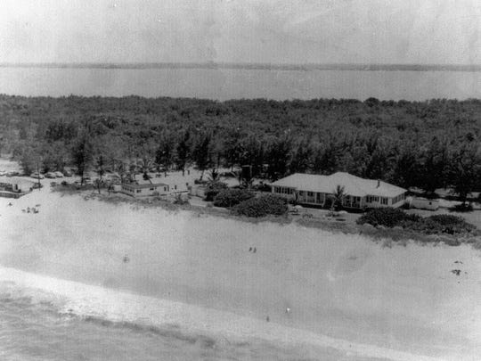 Aerial view in 1951 of the Sandpiper Snack Shop to the left and to the right the Sand Club along the Atlantic Ocean and the Indian River beyond Hutchinson Island.