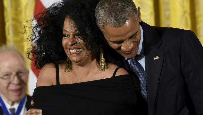 President Barack Obama hugs Diana Ross during the presentation of the Presidential Medal of Freedom.