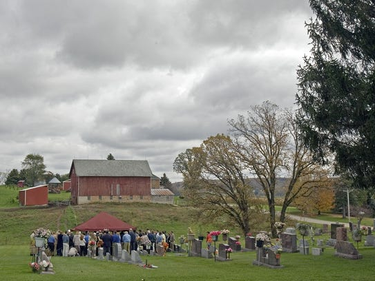 Friends and family gather at the burial of Weston Schools