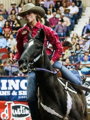 Sarah Rose McDonald races around barrels during Cinch
