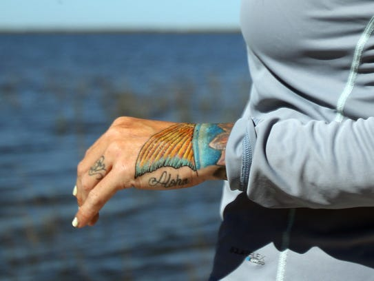 Kacee's latest tattoo of a redfish tail symbolizes