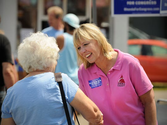 Congressional candidate Rhonda Sivarajah talks with people while campaigning Saturday at the Anoka County Fair.