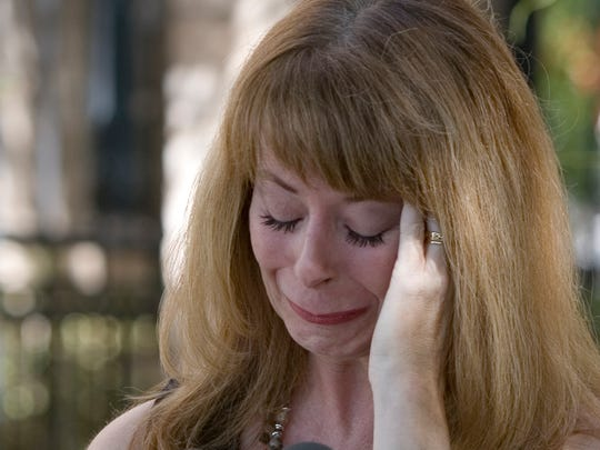 An emotional Wendy Carr,  Mark Goudeau's wife, reads a statement during a press conference on Sept. 15, 2006, in Phoenix.
