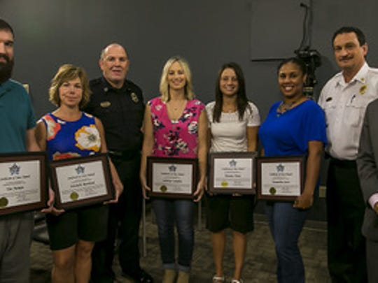 July STARS Award honorees, Dispatcher Tim Juneau, Michelle Rowland, left to right, MPD Assistant Chief Michael Bowen, Communication Supervisor Lindsay Callahan, Dispatchers Bri Dunn, Cassandra Scott, MFRD Chief Mark Foulks, Mayor Shane McFarland. Not pictured, CTO Jessica Christian, James Ray