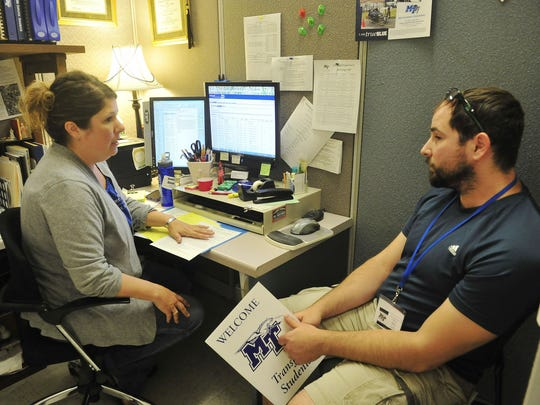 Jennifer Danylo, academic adviser for MTSU's College of Basic and Applied Sciences, talks with transfer student Brian Covell from Columbia State Community College during a special orientation for transfer students.