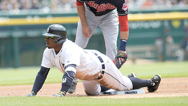 Rajai Davis is safe at third under the tag by Cleveland's Lonnie Chisenhall after hitting a leadoff triple in the first inning Sunday.