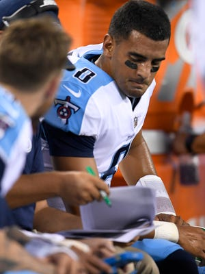 Titans quarterback Marcus Mariota (8) sits on the bench in the first quarter of a preseason game against the Jets at MetLife Stadium Saturday, Aug. 12, 2017 in East Rutherford, N.J..