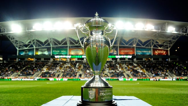 Seattle Sounders FC plays the Philadelphia Union for the U.S. Open Cup final trophy on Tuesday, Sept. 16, 2014, in Chester, Pa. The Sounders FC beat the Union 3-1 in overtime. (AP Photo/Michael Perez)