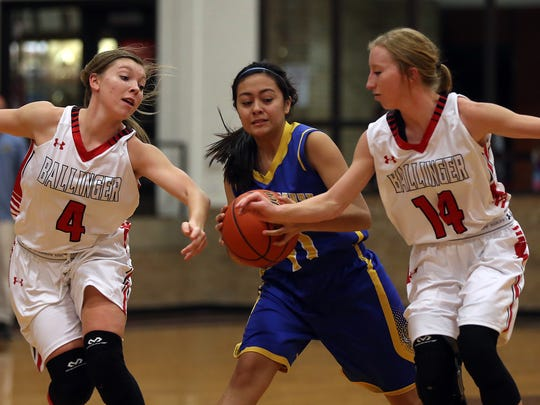 Ballinger's Kinley Gray and Lauren Landers try to steal the ball from Reagan County's Shayla Sosa on Tuesday.