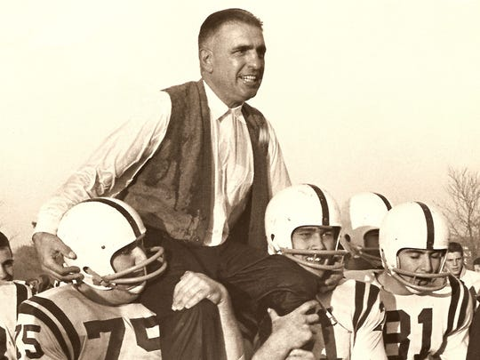 Long Branch head coach Amadeo ``Army'' Ippolito is carried off the field by his players after a big win by the Green Wave in 1960.