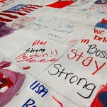 A detailed view of a large homemade painted canvas  on display  on the lawn of the Boston Common on April 16 in Boston. The canvases include written messages from all 50 states as well as some signed and donated by professional sports teams as part of the America For Boston campaign.