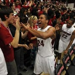 Stanford Cardinal's Josh Huestis (24) celebrates with the student section after their 75-70 win against the California Golden Bears at Maples Pavilion in Stanford, California, on March 4, 2012.
