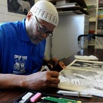 Photo by Andy Barron --- 140220 Inmates in the True Grit program at the Northern Nevada Correctional Center work in the arts and crafts room. The program addresses the special physical, mental, emotional and spiritual needs of elderly inmates.