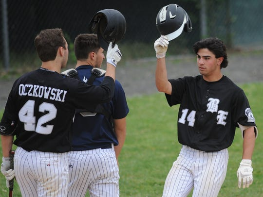 Bishop Eustace's Johnny Piacentino, right, celebrates with teammates after hitting a home run last season.