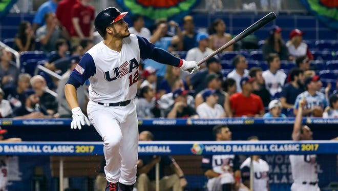 Nolan Arenado hits a home run in the second inning against Canada.