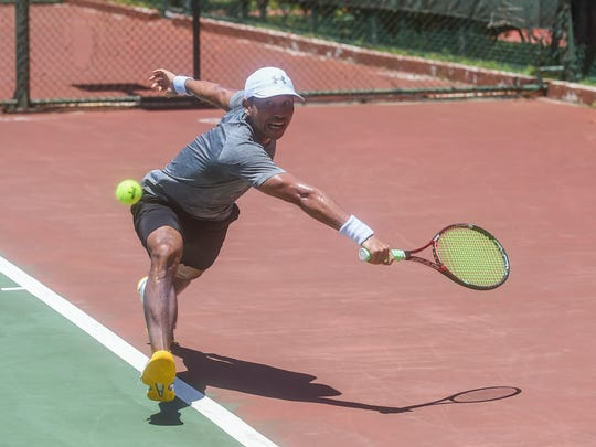Dr. Luan Nguyen lunges for a backhand shot during the 2018 King's Guam Futures Tennis Tournament at the Hilton Guam Resort and Spa on June 16, 2018.